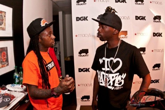 Stevie Looking at Lil Wayne 540x359 - Event Recap: Stevie Williams & Lil' Wayne Unveil New Clothing Lines