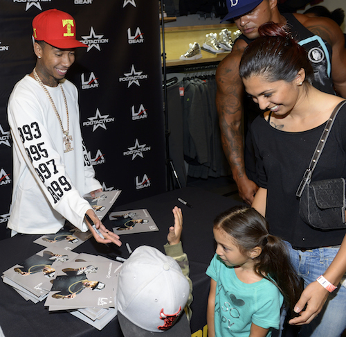 Tyga footaction kidssigning - #StyleWatch : Tyga hosts launch of Liquid Silver Shoe In Las Vegas @MiracleMileLV @LAGear @Tyga
